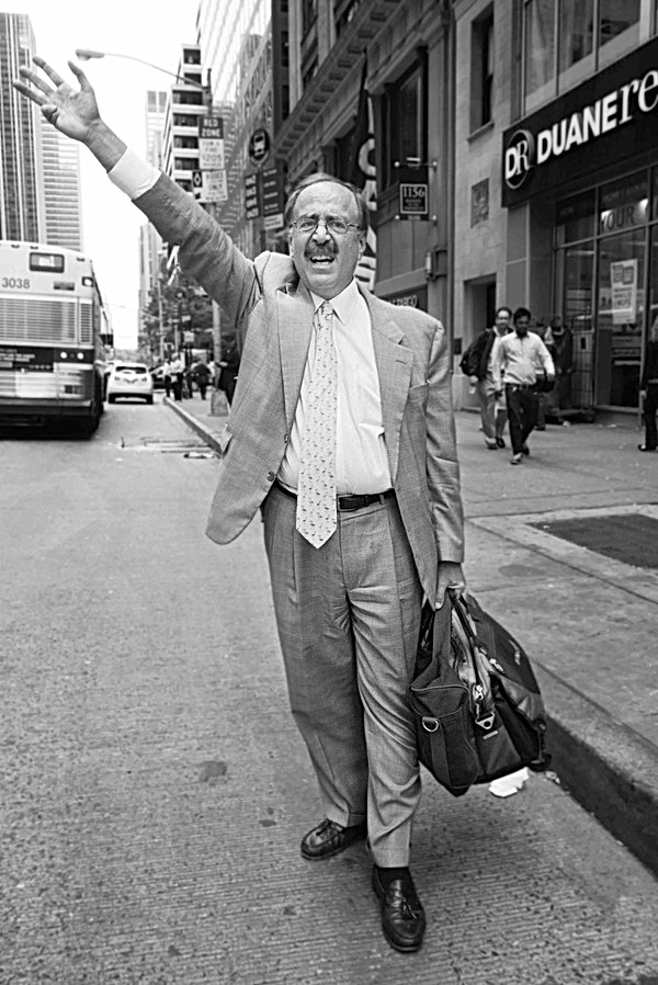 Hailing A Taxi, New York. June 11, 2014.
