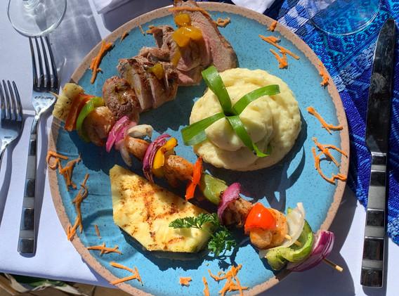 Grilled pork tenderloin w/ pineapple glaze; Caribbean shrimp kebob; mashed potatoes