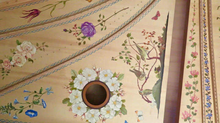 Painting on a harpsichord
