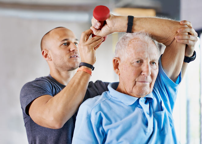 personal trainer working with active older adult