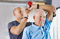 Exercise Physiologist helping man with strength training