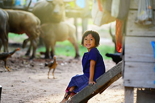 smiling face of a little girl in country asia.             .jpg
