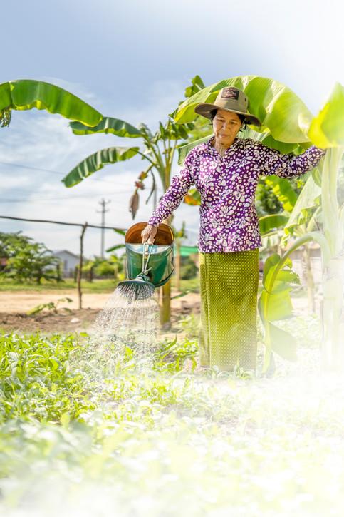 Ry Hon watering her yard