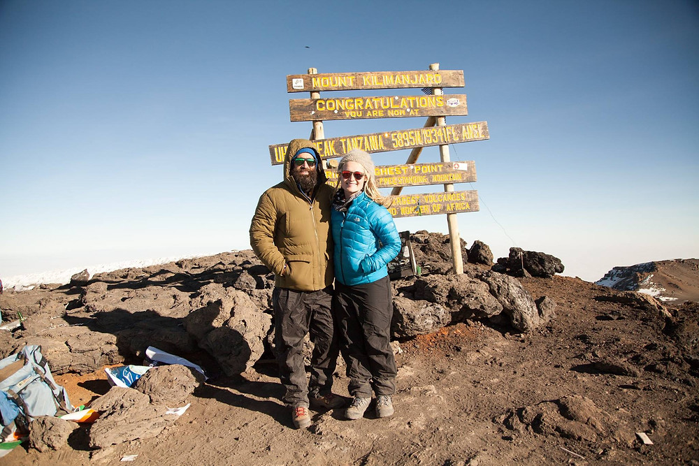 Cecily and I at the summit of Kilimanjaro in 2016, shortly before I vomited all over the mountain.