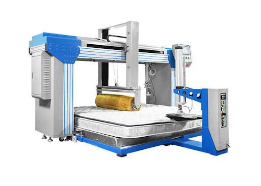Uma máquina de testes da indentação do colchão