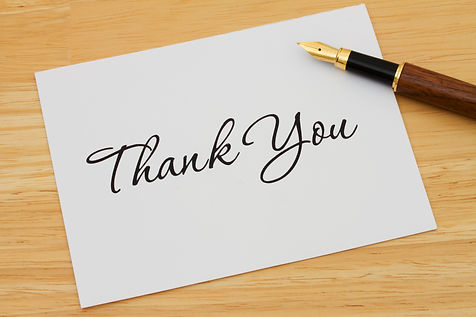 A thank you card with a fountain pen on