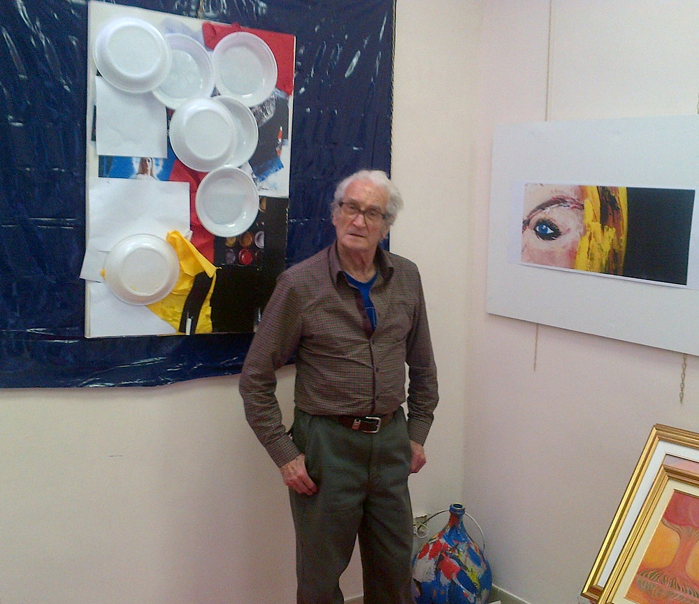 """Photo: Armando Farina busy setting up the exhibition in Turin. It's an honour for me to have my artwork """"Vision"""" exhibited alongside Armando Farina's work in Turin."""