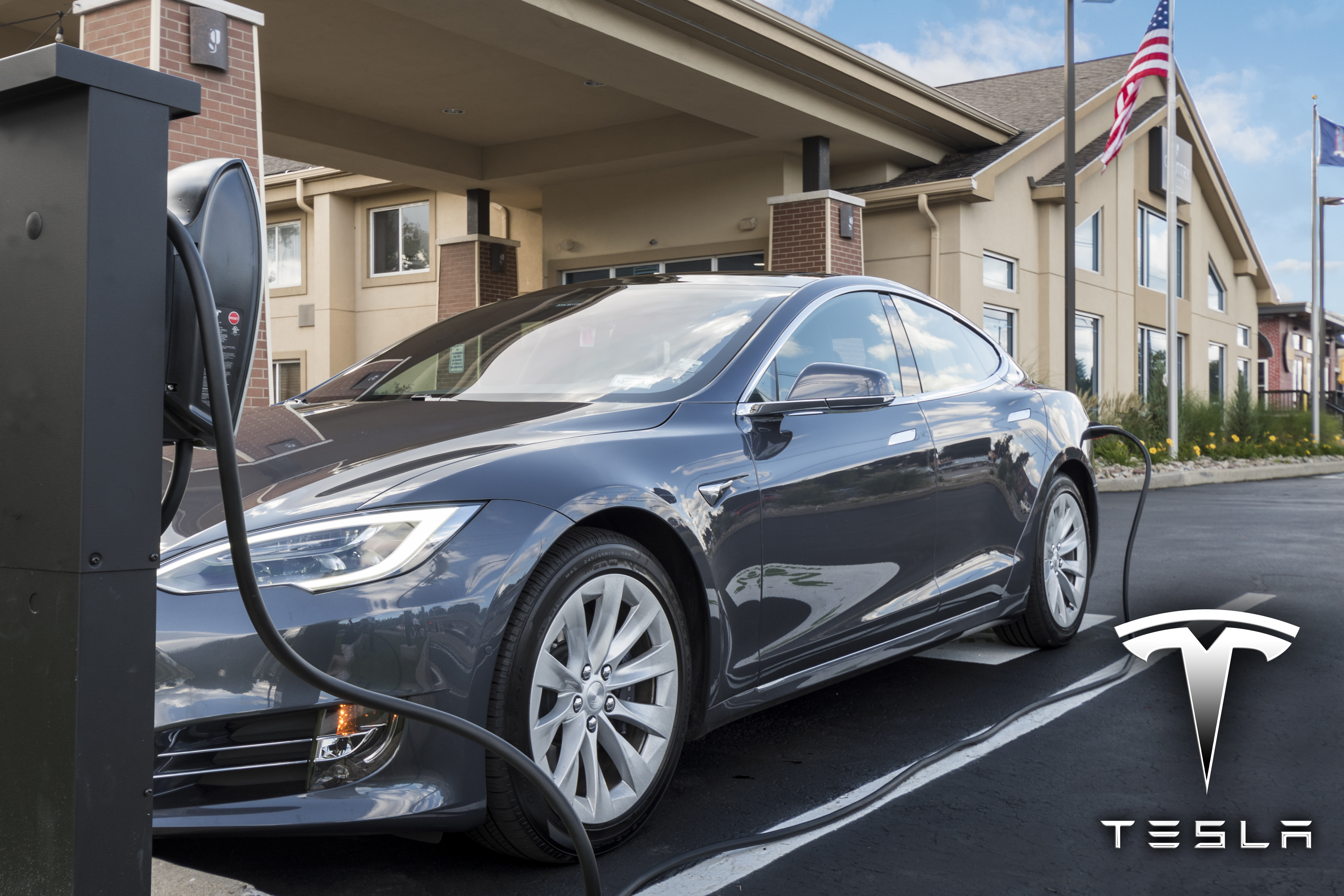 Tesla Charger Plugged in high res