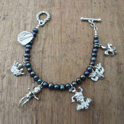 Mardi Gras Charm Bracelet with Peacock Pearls copyright by Maurice Milleur