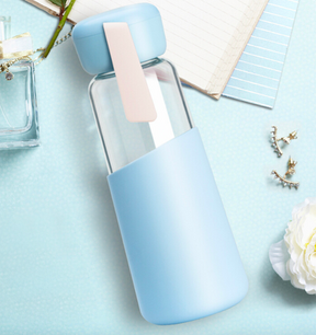 Glass bottle with silicone holder