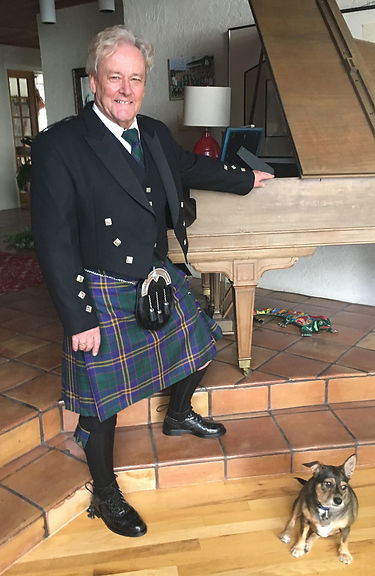 Guy Butler at home in Orlando, Florida, wearing the Kilkenny tartan of his family's ancestral home.