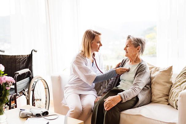 Health worker with senior women lo.jpg