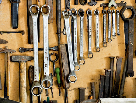 organized boards, tools, hammer, wrench, nails, screw driver