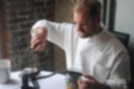 Martin Heuser smoking spinach salad in a jar at modern german dining restaurant in Kansas City