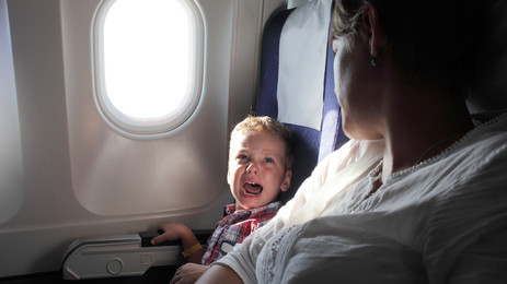 Crying Baby on Airplane Applauded for covering up Sound of Adam Sandler Movie