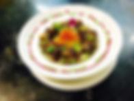 Marmitte de joue de boeuf fondante au vin rouge, galangal et citronnelle, mousseline de patate douce au lait de coco, tombée de brède, zest d' agrumes confits et chiffonnade de serrano