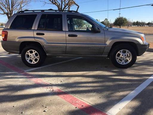 1999 Bright Platinum Metallic Jeep Grand Cherokee Laredo