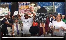 "Protestors shout ""Valerie Gaiter"" outside Legislative Office Building"
