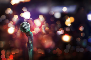 Close up of microphone in concert hall or conference room.jpg