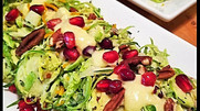 Shaved Brussels Sprout, Pear and Pomegranate Salad with Orange Ginger Dressing