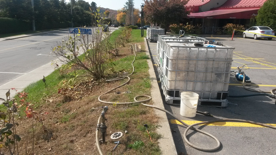 Decontamination of Soil and Water under a Parking Lot