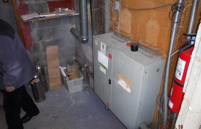 Immeuble à logement contaminé à l'huile à chauffage