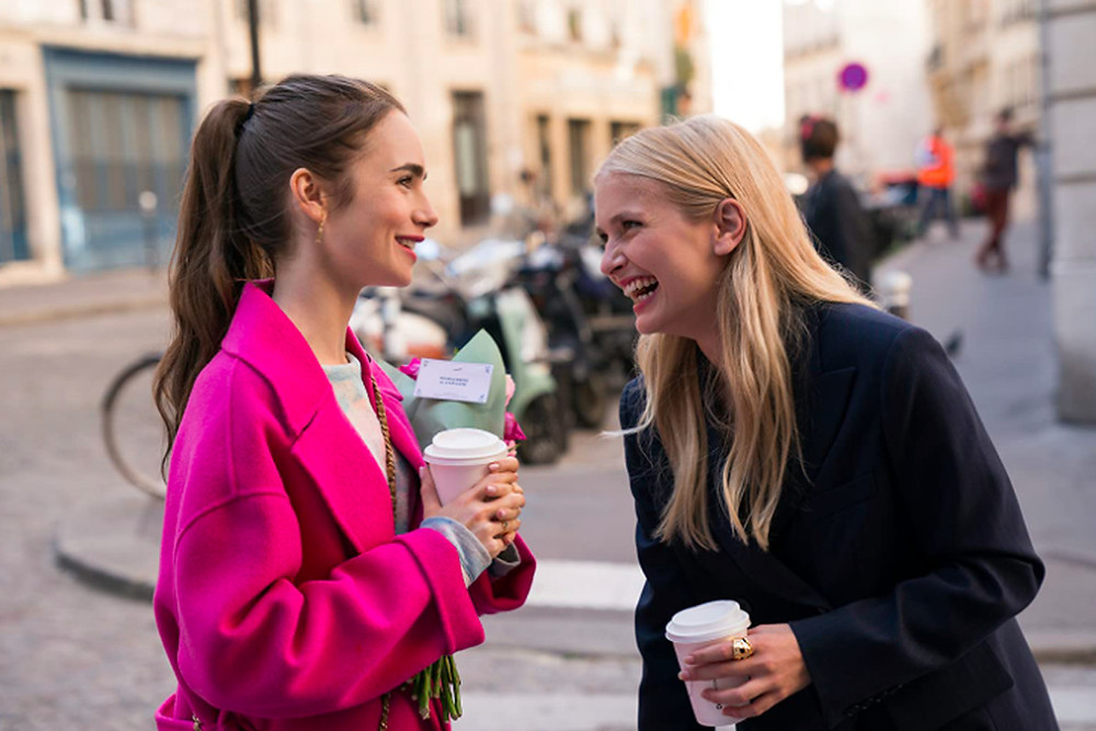 Emily from Emily in Paris enjoys a coffee with her friend