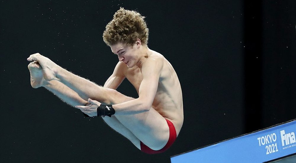 Wiens Rylan of Canada performs a dive during the men's 10-meter platform final at the FINA Diving World Cup in Tokyo.