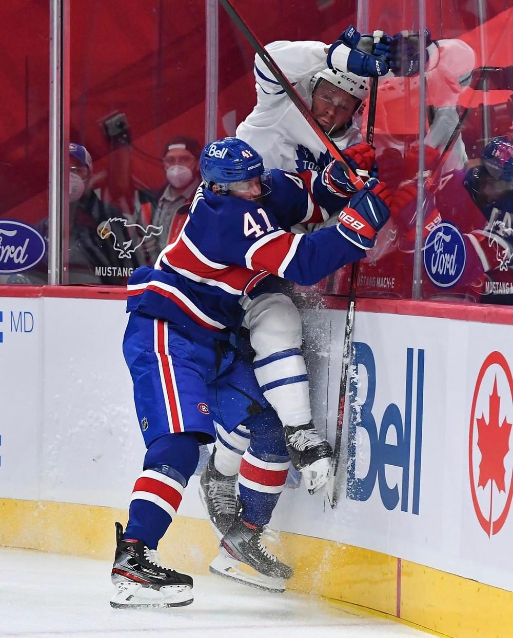 Canadiens forward Paul Byron finishes a body check on Leafs d-man Morgan Reilly