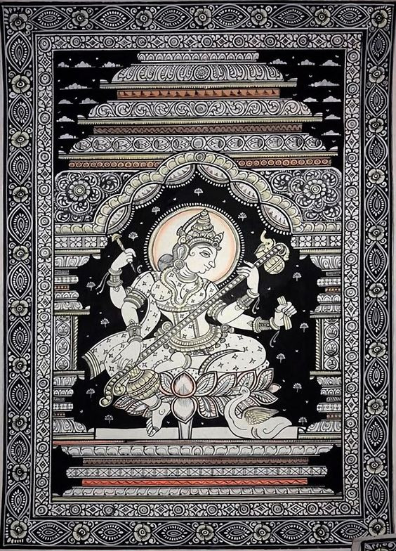 A black scroll painting with white designs