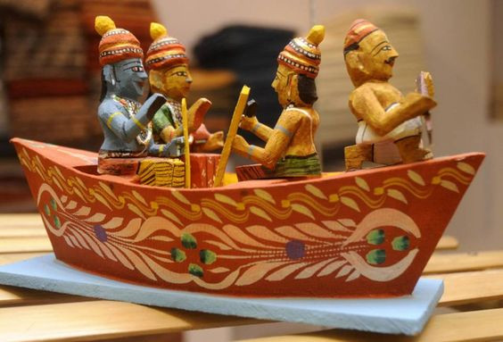 A colorful boat containing four men