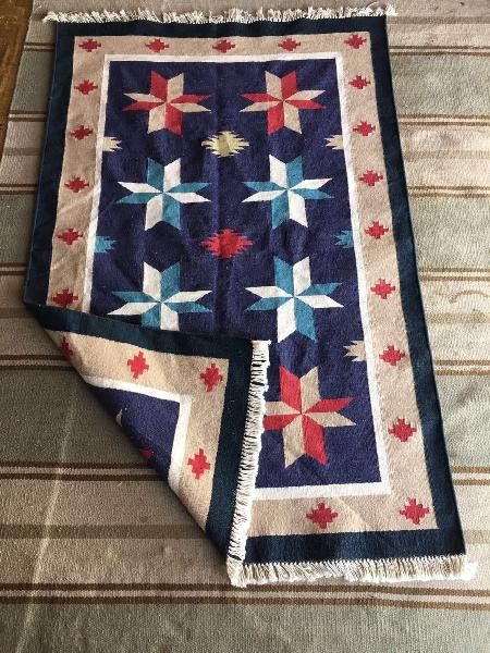 Multicolored rugs in various colors and having several patterns