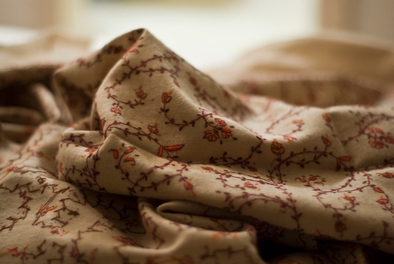 Cream shawl with red embroidery