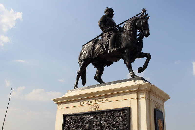 Statue of a man riding a horse with a weapon in his hand