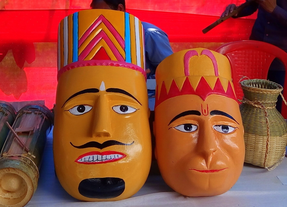 Masks of two men wearing traditional hats
