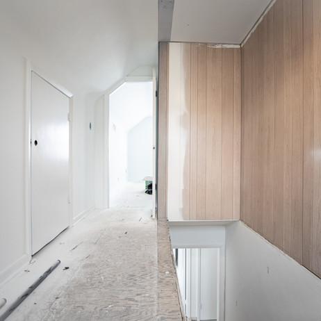 BEFORE: Second floor hallway