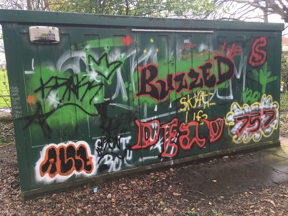 Building covered in graffiti documented and reported
