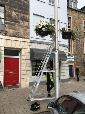Assisting Bloom with hanging baskets