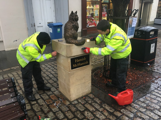 Cleaning Hamish statue and plinth