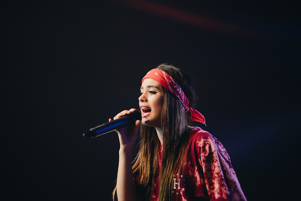 Young Teen Female Singer on Stage Performing