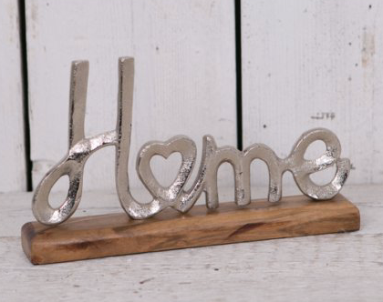 Metal Home Sign on Wooden Block