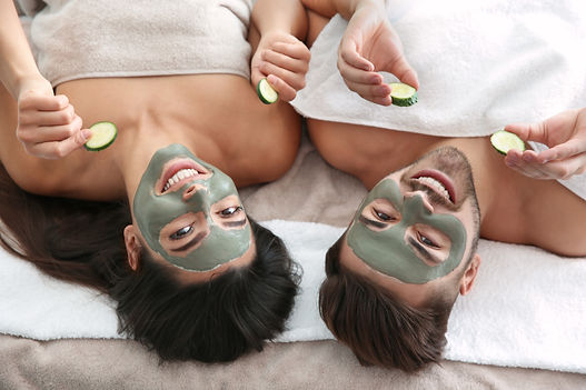 Happy couple enjoying facial treatment p