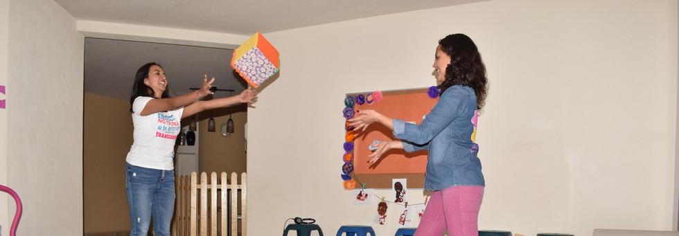 Seidy and Karen tossing a cube.JPG
