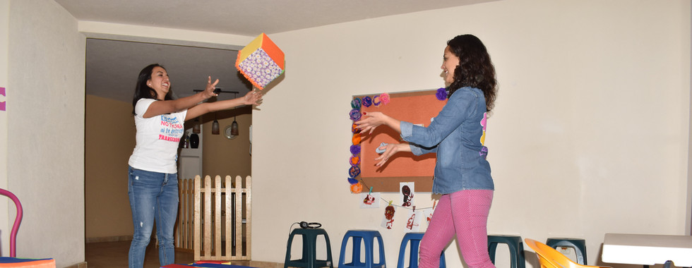 Seidy and Karen tossing a cube.JPG