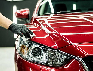 Ceramic coating being applied to a vehicle