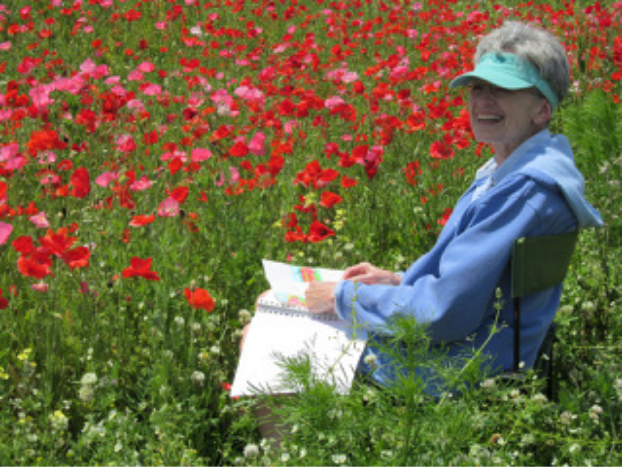 Bonnie painting in poppies