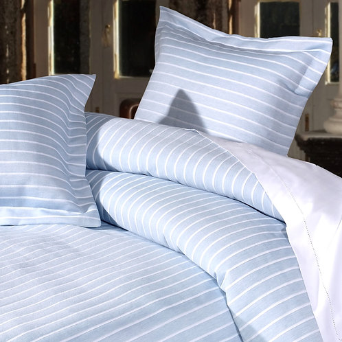 Image of bed with Stripes sky blue duvet cover and pillowcases