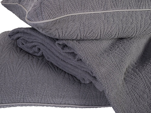 Close up image of Buxton bedspread and cushion cover in charcoal colour