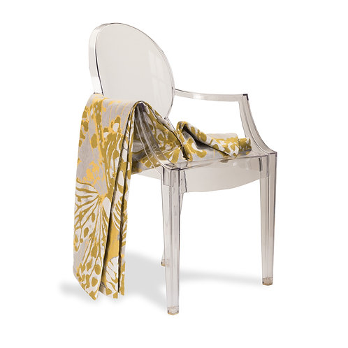 Image of white chair with Marsh bedspread in ochre draped over arm