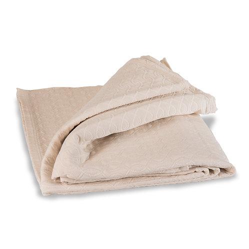 Folded Ludlow bedspread in ivory